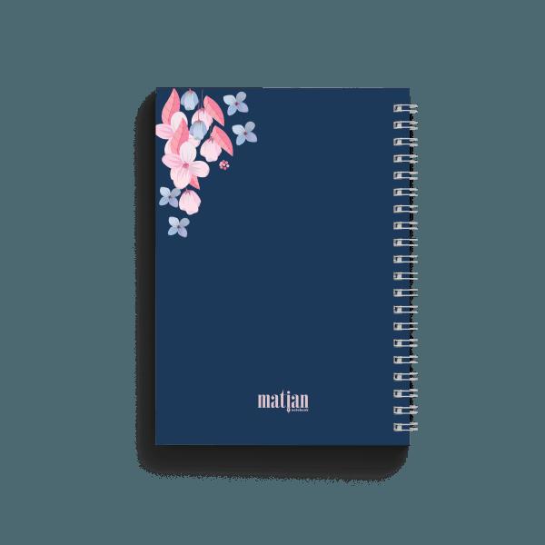 blue notebook with floral design back